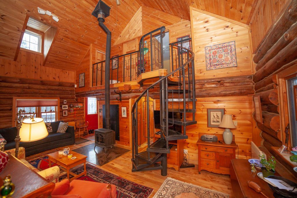 rustic log cabin interior real estate photo